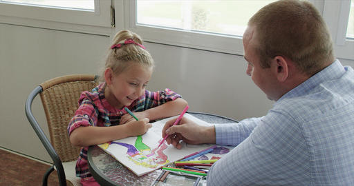 Father and his smiling little girl daughter play and draw together SLOW MOTION ビデオ