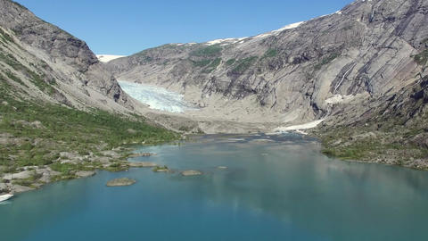 View of the Nigardsbreen Glacier. Mountains and Lake In Norway Footage