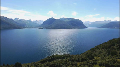 The coastline of the lake in Norway. Forests and mountains Footage