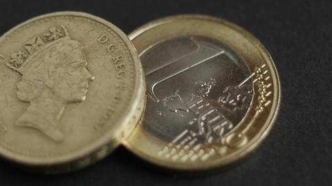Pound Coins and Euro coins with macro shot Footage