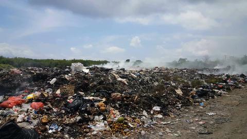 Waste and garbage disposal on Lembongan island, Bali Live Action