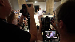 Media. The cameraman shoots the fashion show Footage