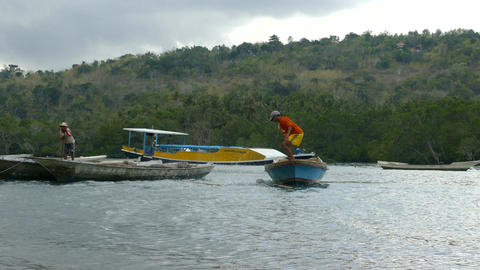 Fishermen at work at Yellow bridge, Lembongan, Bali Footage