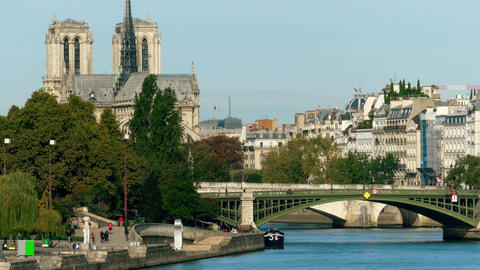 Residential houses on the Seine river embankment and famous Notre-Dame Cathedral Footage