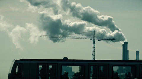 PARIS, FRANCE - OCTOBER 7, 2017. Smoking pipes and tower crane silhouette Footage