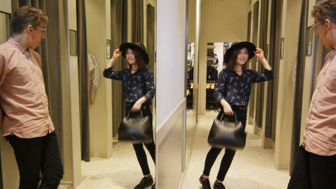 Girl Goes out of Dressing Room with Black Bag and Hat Footage