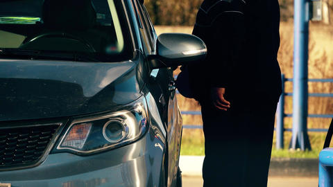 Unrecognizable man refuels his car at the filling station Footage