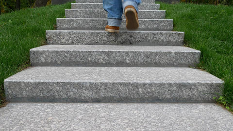 Man in Blue Jeans Rises on Granite Steps at Memory Wall or Tombstone Footage