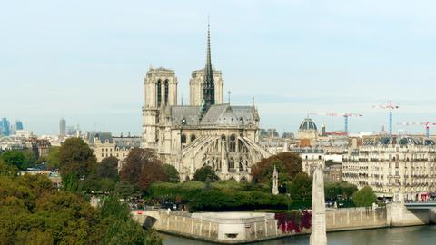 Notre-Dame Cathedral and the Seine river embankment on sunny autumn day フォト