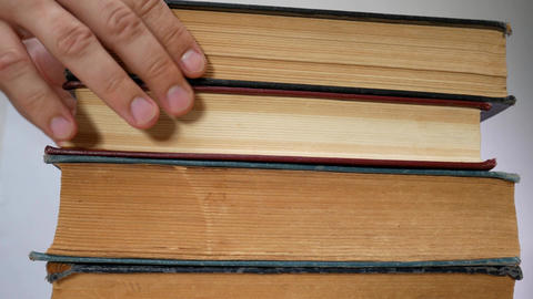 Student's Hands Take Old Books One On Another Footage