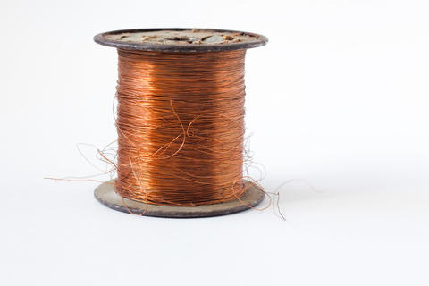 Copper wire on spool, isolated on white backgrounds, with clipping paths on フォト