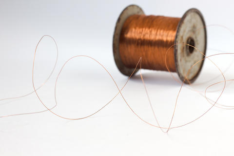 Bundle of thin cooper wire on white background Foto