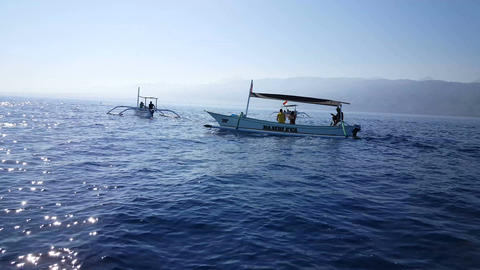 Traditional fishing boats on Bali Sea are waiting for dolphins Footage