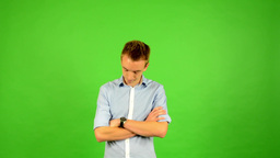 man - green screen - portrait - man waits (waiting) - man looks at his watch Footage