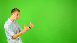 man - green screen - portrait - man agrees (shows thumbs up for approval) Footage