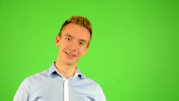man - green screen - portrait - man welcomes people - man invites people with ha Footage