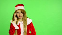 Christmas - Holidays - young attractive woman - green screen - woman on the phon Footage