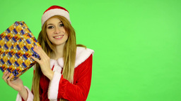 Christmas - Holidays - young attractive woman - green screen - woman gets a gift Footage