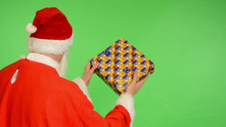 santa claus - green screen - studio - santa claus standing back and offering a g Footage