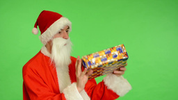 santa claus - green screen - studio - Santa Claus gets a gift and is surprised Footage