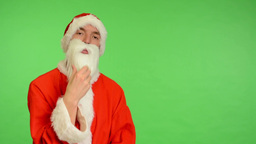 santa claus - green screen - studio - Santa Claus is thinking and strokes his be Footage