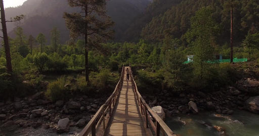 Man Walks Across Wooden Bridge Footage