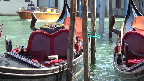 Gondola boats parking. Gondola moored, Venice, Italy. Italian gondola paddle Live Action
