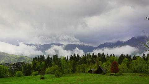 Mountain alps house and trees in fog clouds Footage