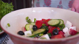 Stirring the Greek salad with butter and cheese Footage