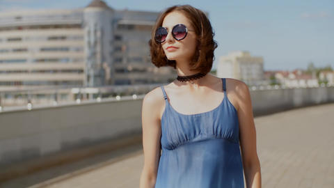 Young woman walking in the city with industrial background Footage