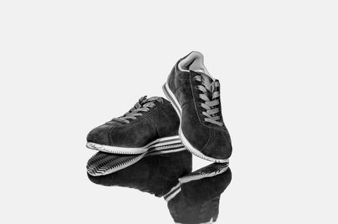 black and white photo. pair of new blue sneakers Photo