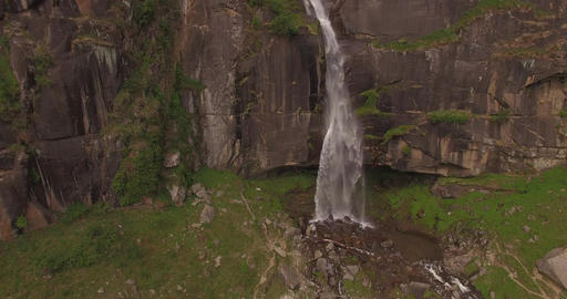 Waterfall Splashes onto Rocks at Cliff Base Footage