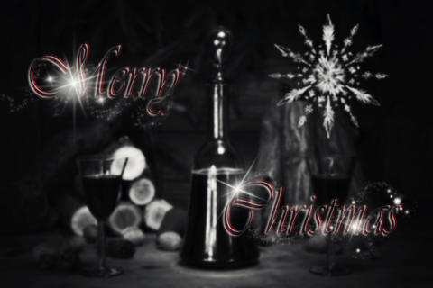 Merry Christmas Sign With Red Wine Vintage Bottle and Glasses Resting On Wooden フォト