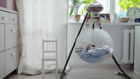 baby sleeping in swinging cradle Footage