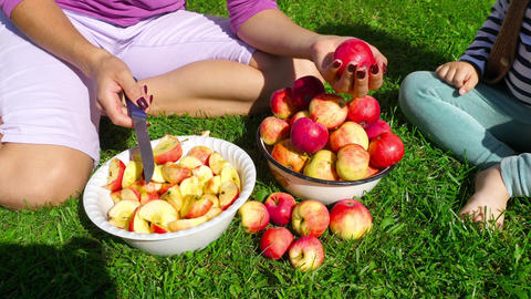 Woman cuts apples for jam Footage
