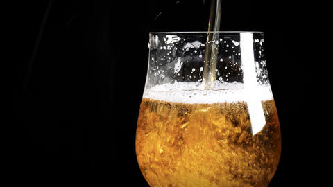 Close up - pouring light beer into glass Live Action