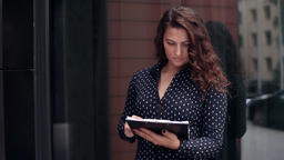 Young attractive business woman looking at documents with serious look near Footage