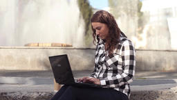 Business woman using laptop on a break outdoors, beautiful female student Footage