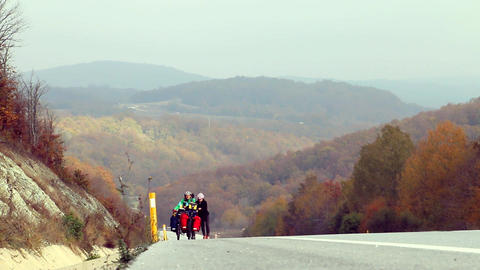 Autumn view with walking cyclists ビデオ