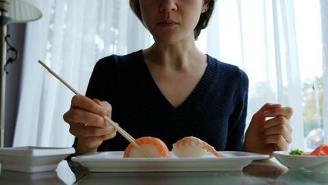 young caucasian girl eating sushi in Japanese restaurant Footage