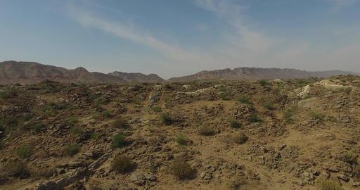 Flying Backwards Over Rocky Desert Landscape Footage