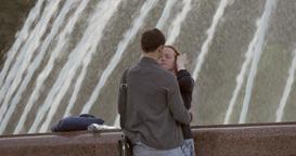 Romantic kissing near fountain Footage