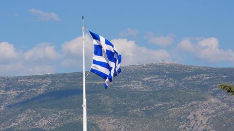 One single greek flag on acropolis hill, athens, greece, 4k Footage