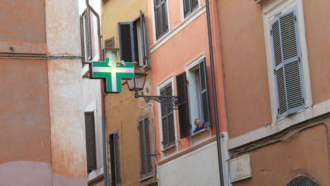 ROME - ITALY, AUGUST 2015: pharmacy shop sign and woman Footage