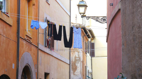 ROME - ITALY, AUGUST 2015: traditional laundry, clothes linen street Footage