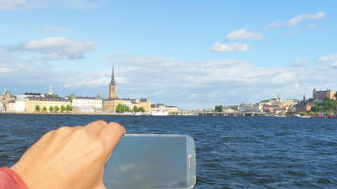 tourist taking picture in sightseeing tour, stockholm, sweden Footage
