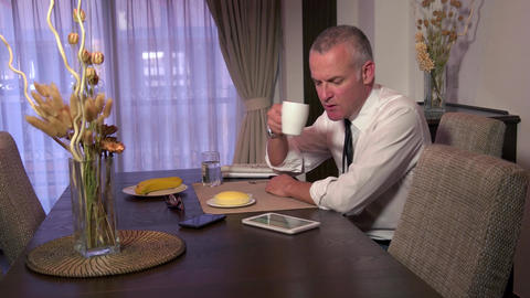 Businessman Using Ipad Tablet For Work During Breakfast At Home Footage