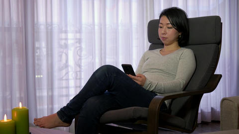 Happy Asian Girl Woman Text Messaging Texting On Smartphone Phone Footage