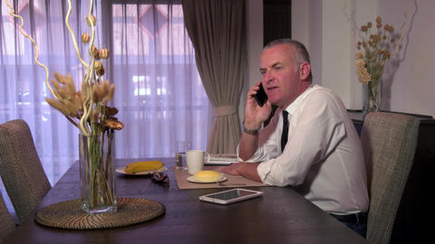Man Business People With Ipad Telephone Mobile Phone At Breakfast Footage