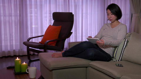 Woman Girl Relaxing On Sofa At Home With Ipad Tablet Footage